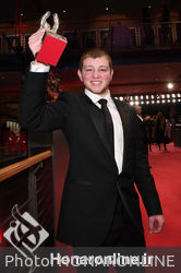Anthony Bajon_ winner of the Silver Bear for Best Actor for _The Prayer__ poses with his award after the closing ceremony during the 68th Berlinale International Film Festival