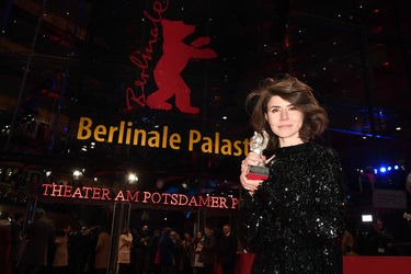 Malgorzata Szumowska_ winner of the Silver Bear Grand Jury Prize for _Mug_ poses on the red carpet after the closing ceremony during the 68th Berlinale International Film Festival