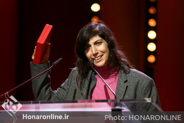 Ines Moldavsky receives the Short film Award in Gold for the movie _The Men Behind the Wall_ at the closing ceremony during the 68th Berlinale International Film Festival