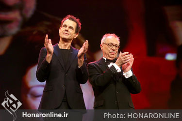 Tom Tykwer and Dieter Kosslick are seen on stage at the closing ceremony during the 68th Berlinale International Film Festival
