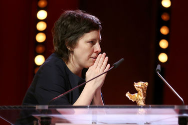 Adina Pintilie receives the Golden Bear for Best Film for _Touch me not_ at the closing ceremony during the 68th Berlinale International Film Festival