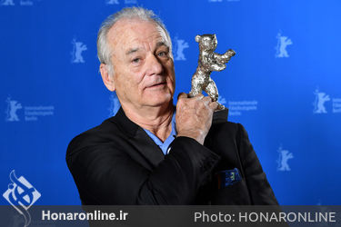Bill Murray poses with the award he accepted for Wes Anderson_ winner of the Silver Bear for Best Director for _Isle of Dogs__ at the Award Winners photo call during the 68th Berlinale International Film Festival