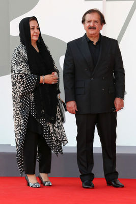 02 Director Majid Majidi and a guest walk the red carpet ahead of the movie Khorshid (Sun Children) at the 77th Venice Film Festival on September 06_ 2020 in Venice_ Italy.1